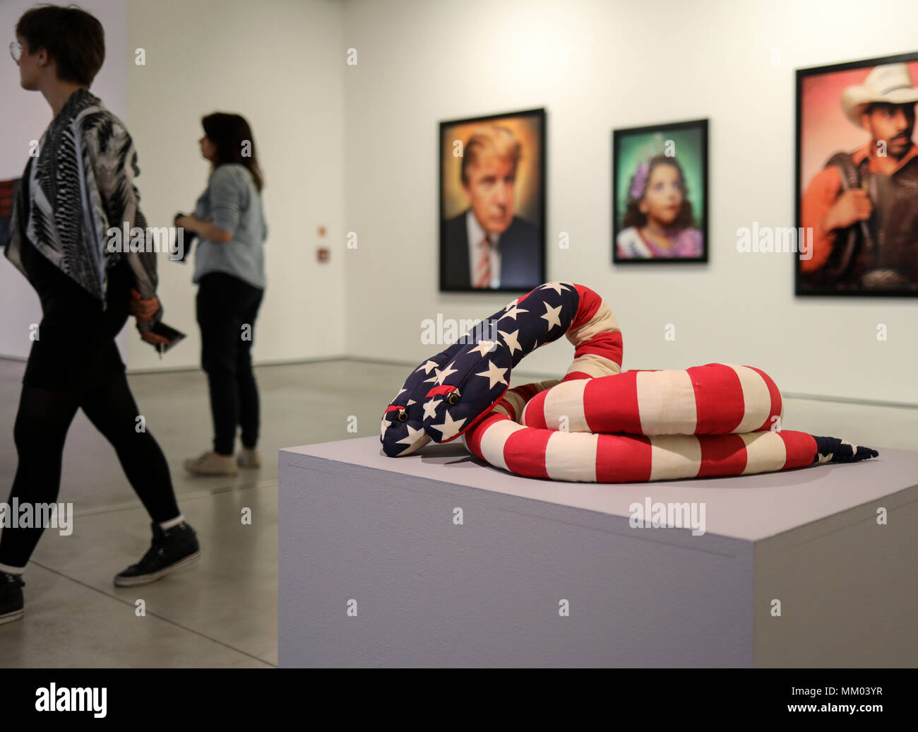 Cracow, Poland - May 8, 2018: Exibition Motherland in Art at Mocak in Krakow. Melissa Vanderberg - Polycephalic Patriot. Two-headed plush snake, made from pieces of flags is a criticism of a two party politicial system Credit: Wieslaw Jarek/Alamy Live News - Stock Image