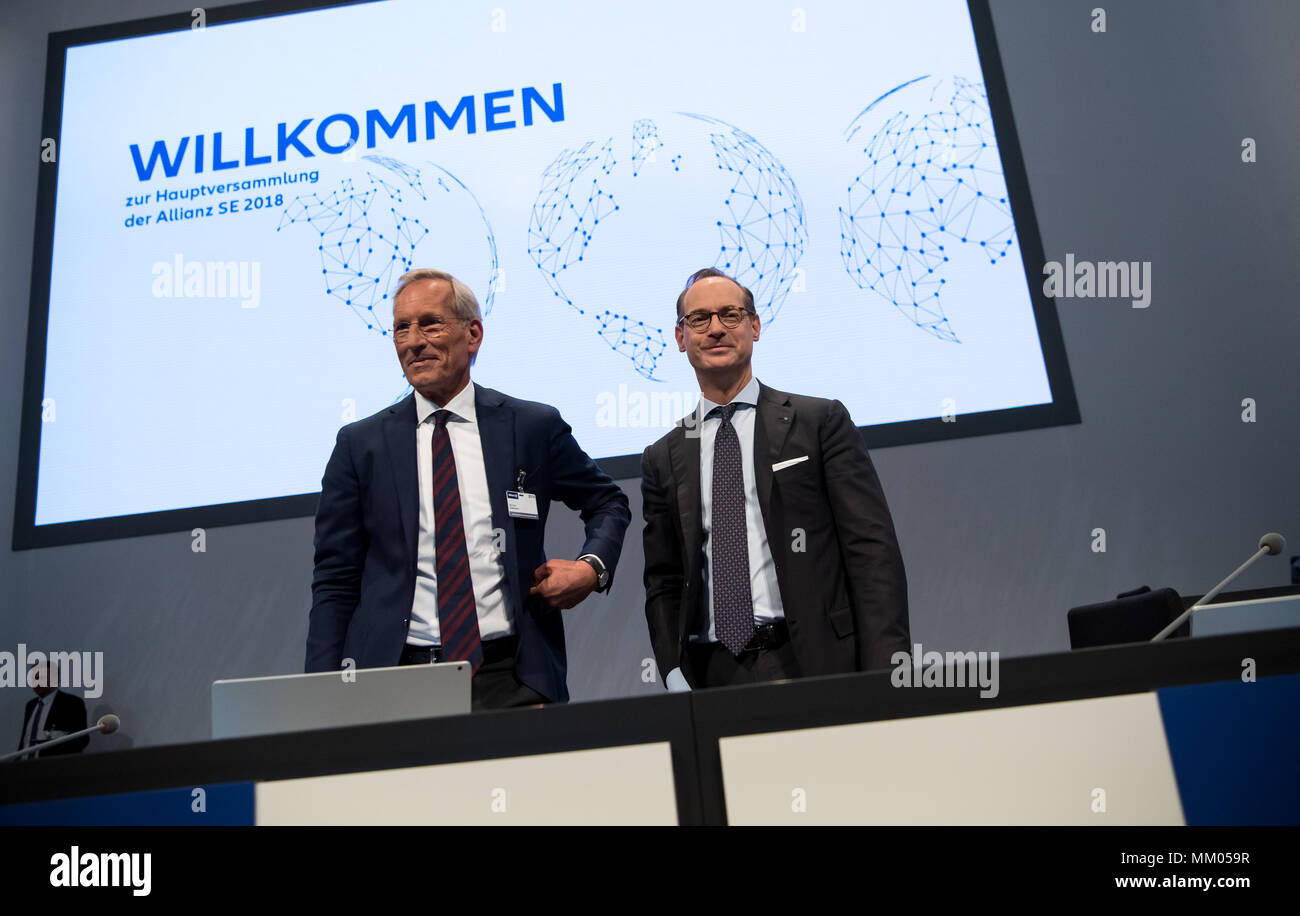 09 May 2018, Germany, Munich: CEO of the insurance company Allianz SE, Oliver Baete (R), and chairman of the board Michael Diekmann standing onstage before the begin of the annual general meeting of the insurance company Allianz. Photo: Sven Hoppe/dpa Stock Photo