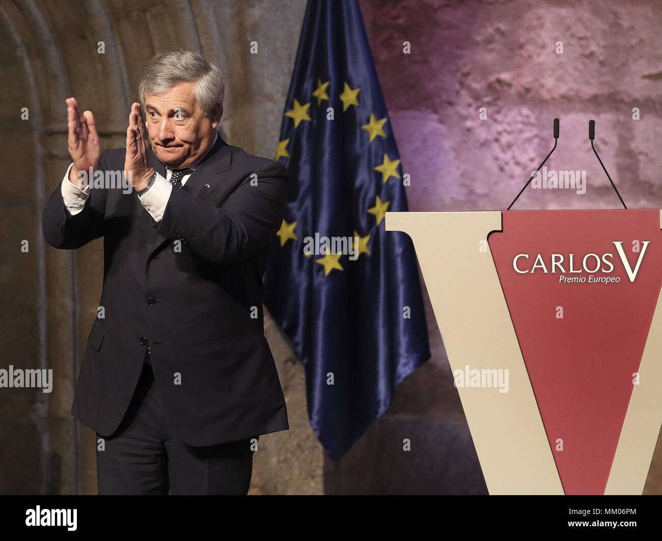 President of EU Parliament, Italian Antonio Tajani, applauds after receiving the Carlos V European Award from Spain's King Felipe VI (not pictured) during the handover ceremony of the XII Carlos V European Award at the Monastery of Yuste in Caceres, Spain, 09 May 2018. EFE/ Ballesteros - Stock Image
