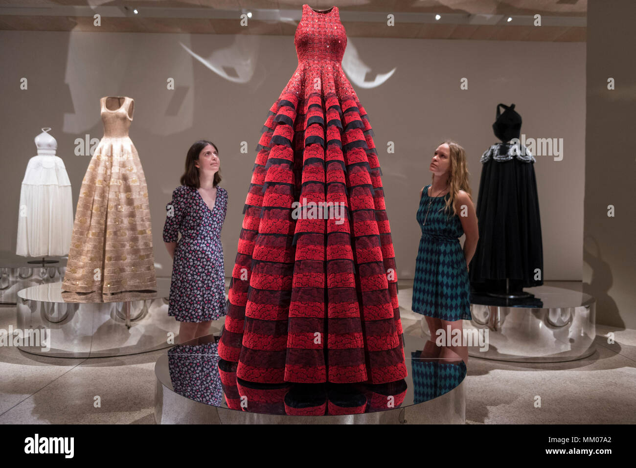 London, UK.  9 May 2018.  Staff members pose at the preview of 'Azzedine Alaïa:  The Couturier', the first UK exhibition of Azzedine Alaïa examining the work of one of the most respected fashion designers in history.  Over 60 rare and iconic garments are on display alongside a series of specially commissioned pieces.  The exhibition runs 10 May to 7 October 2018 at the Design Museum.   Credit: Stephen Chung / Alamy Live News - Stock Image