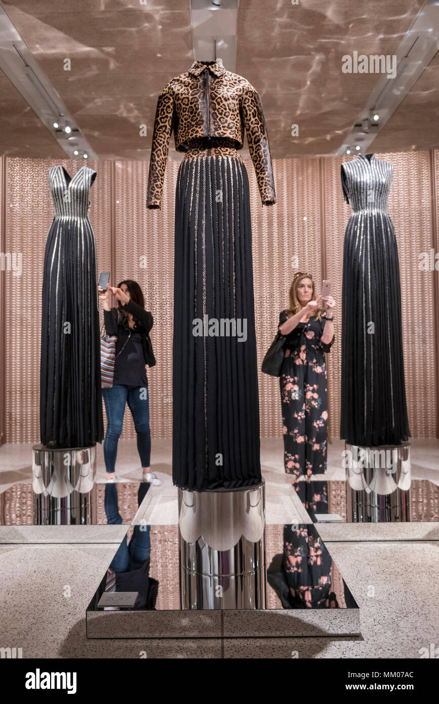 London, UK.  9 May 2018.  Visitors take a photo at the preview of 'Azzedine Alaïa:  The Couturier', the first UK exhibition of Azzedine Alaïa examining the work of one of the most respected fashion designers in history.  Over 60 rare and iconic garments are on display alongside a series of specially commissioned pieces.  The exhibition runs 10 May to 7 October 2018 at the Design Museum.   Credit: Stephen Chung / Alamy Live News - Stock Image