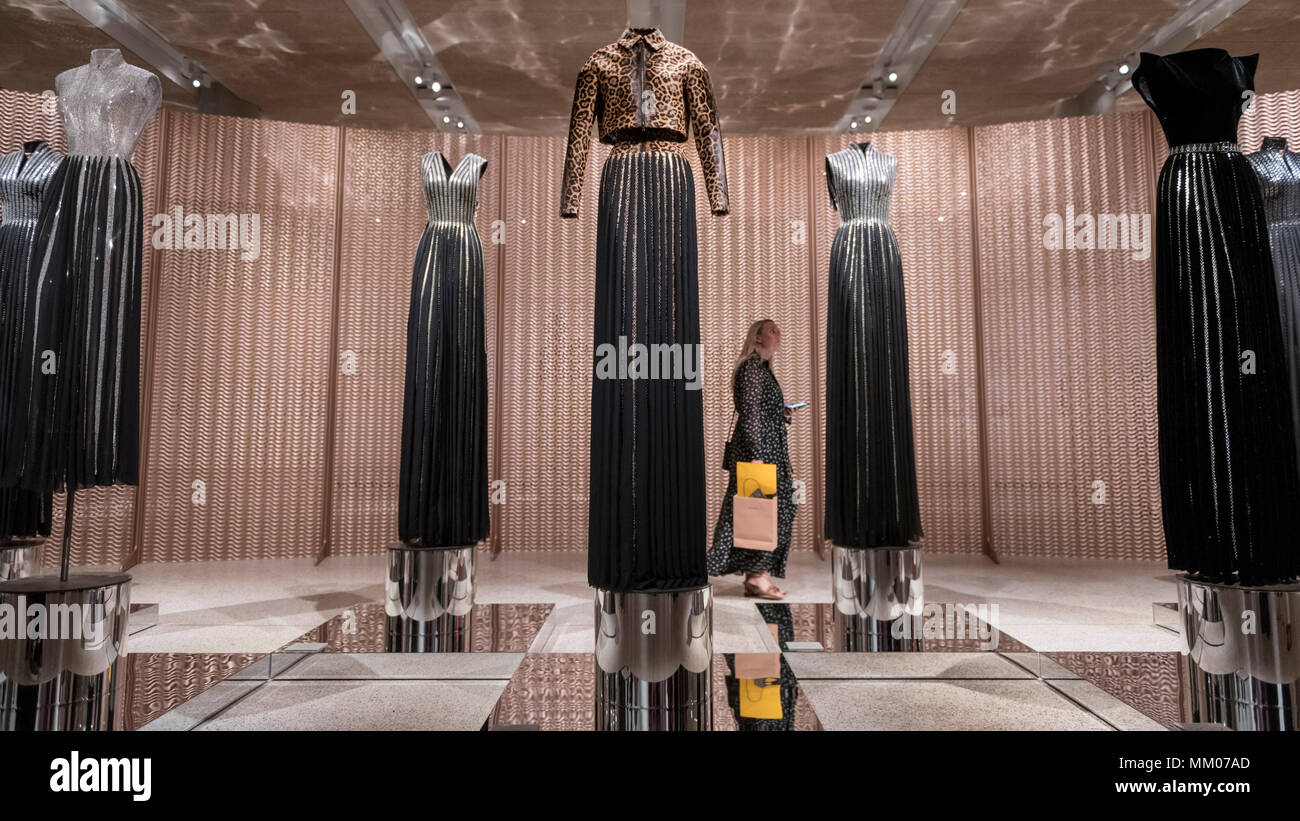 London, UK.  9 May 2018.  A visitor at the preview of 'Azzedine Alaïa:  The Couturier', the first UK exhibition of Azzedine Alaïa examining the work of one of the most respected fashion designers in history.  Over 60 rare and iconic garments are on display alongside a series of specially commissioned pieces.  The exhibition runs 10 May to 7 October 2018 at the Design Museum.   Credit: Stephen Chung / Alamy Live News - Stock Image