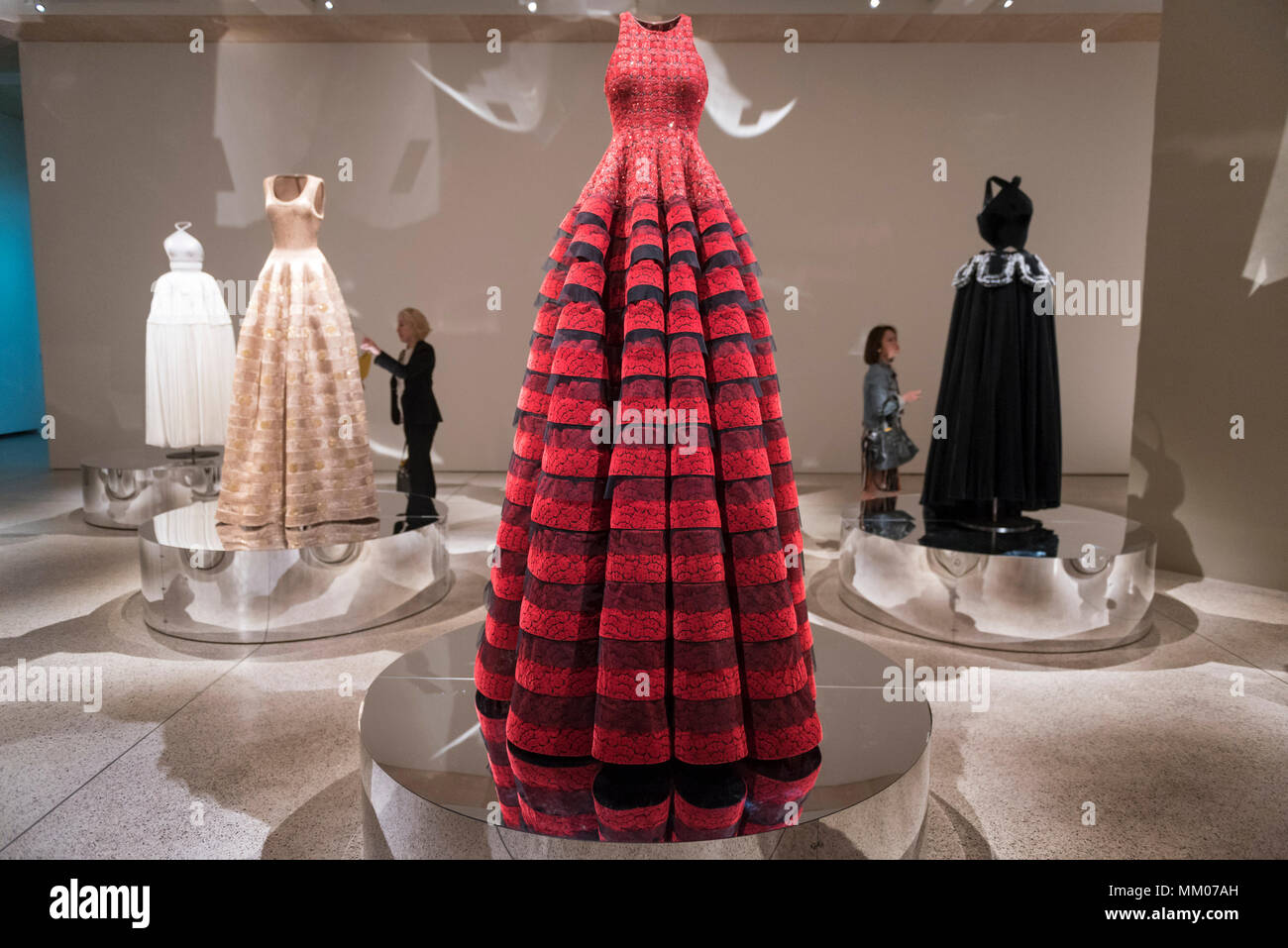 London, UK.  9 May 2018.  Visitors at the preview of 'Azzedine Alaïa:  The Couturier', the first UK exhibition of Azzedine Alaïa examining the work of one of the most respected fashion designers in history.  Over 60 rare and iconic garments are on display alongside a series of specially commissioned pieces.  The exhibition runs 10 May to 7 October 2018 at the Design Museum.   Credit: Stephen Chung / Alamy Live News - Stock Image