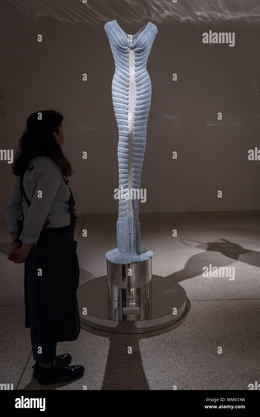 London, UK.  9 May 2018.  A staff member at the preview of 'Azzedine Alaïa:  The Couturier', the first UK exhibition of Azzedine Alaïa examining the work of one of the most respected fashion designers in history.  Over 60 rare and iconic garments are on display alongside a series of specially commissioned pieces.  The exhibition runs 10 May to 7 October 2018 at the Design Museum.   Credit: Stephen Chung / Alamy Live News - Stock Image