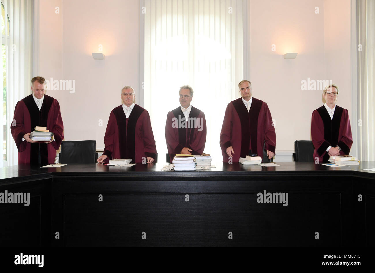 09 May 2018, Germany, Karlsruhe: The First Civil Chamber at the Federal Supreme Court (BGH), Joern Feddersen (L-R), Wolfgang Schaffert, Thomas Koch (chair), Wolfgang Kirchhoff and Christiane Schmaltz, arrive for the trial. The Federal Supreme Court is negotiating whether the music platform Youtube bears liability for copyright infringements of their users. A music producer has been suing the Google subsidiary for ten years. Photo: Uli Deck/dpa Stock Photo
