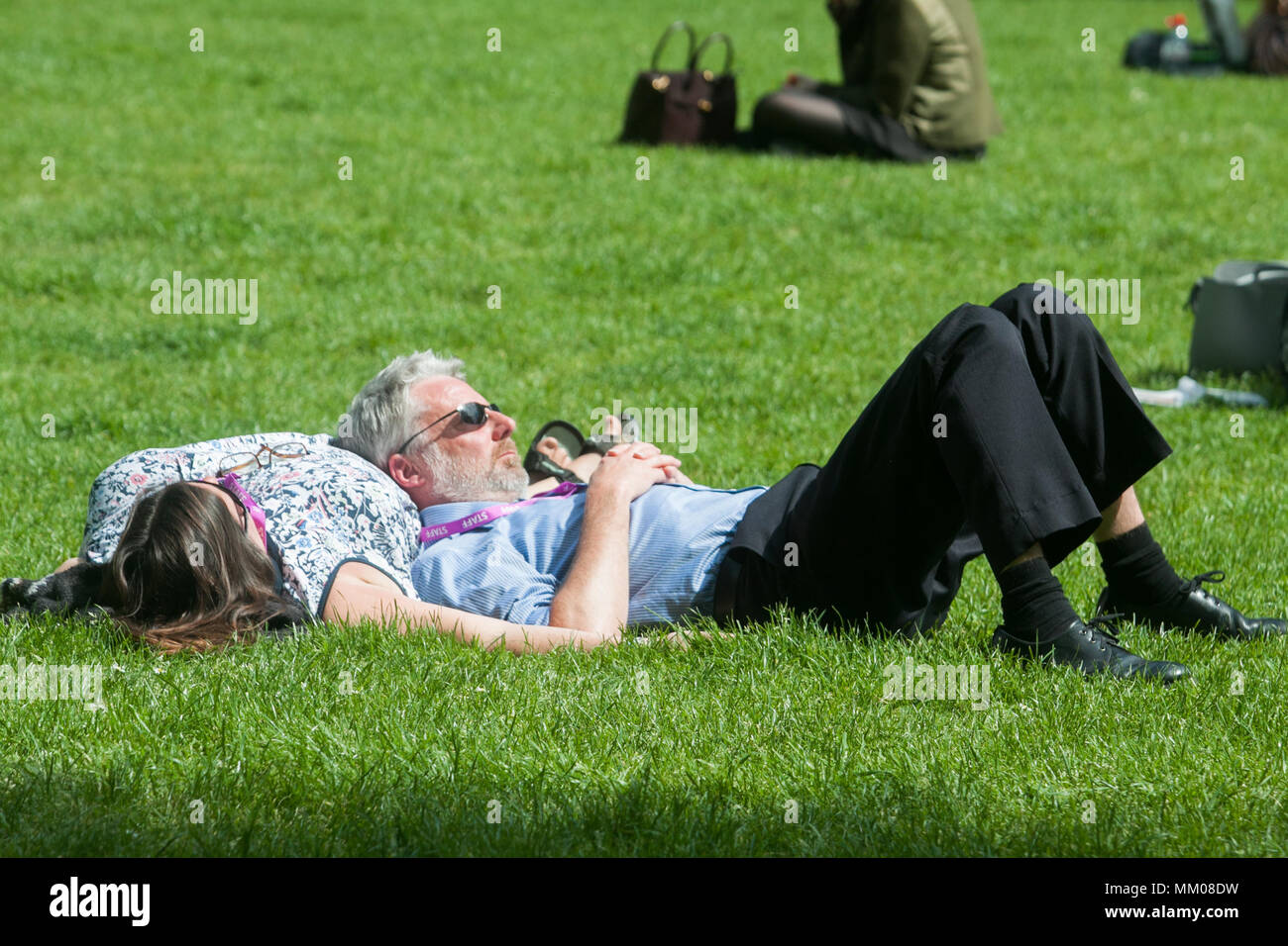 People Sunbathing And Relaxing The Spring Sunshine In Victoria Gardens  Westminster Although Temperatures Have Cooled Down After The Hot May Bank  Holiday ... Good Looking