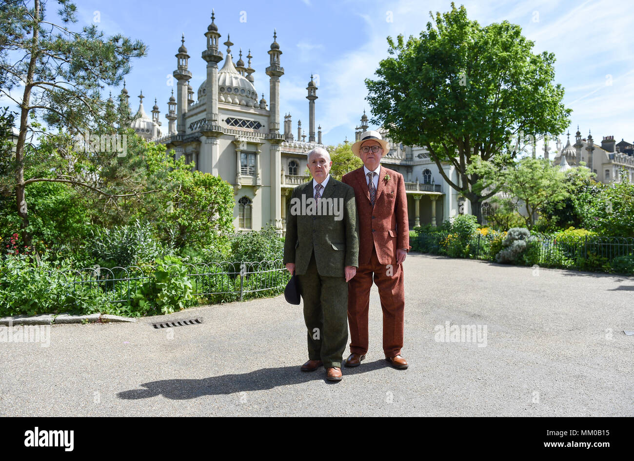 Brighton UK 9th May 2018 - Renowned artists Gilbert (left) and George in the Royal Pavilion Gardens in Brighton before visiting their exhibition at Brighton Museum and Art Gallery which is showing until September until September .  Photograph taken by Simon Dack Credit: Simon Dack/Alamy Live News Stock Photo
