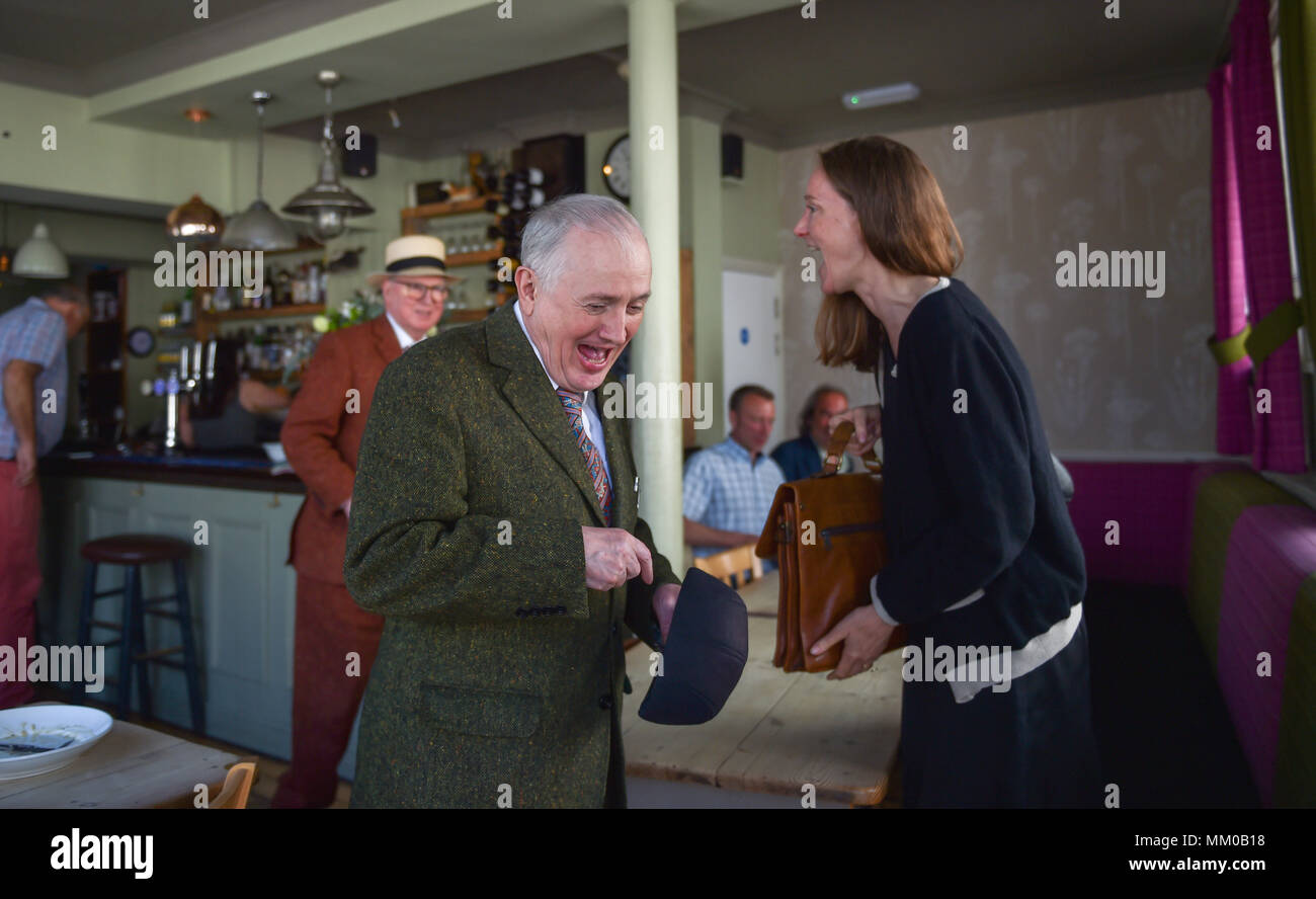 Brighton UK 9th May 2018 - Renowned artists Gilbert and George enjoyed a pub lunch before visiting their own exhibition at Brighton Museum and Art Gallery which is showing until September until September .  Photograph taken by Simon Dack Credit: Simon Dack/Alamy Live News Stock Photo