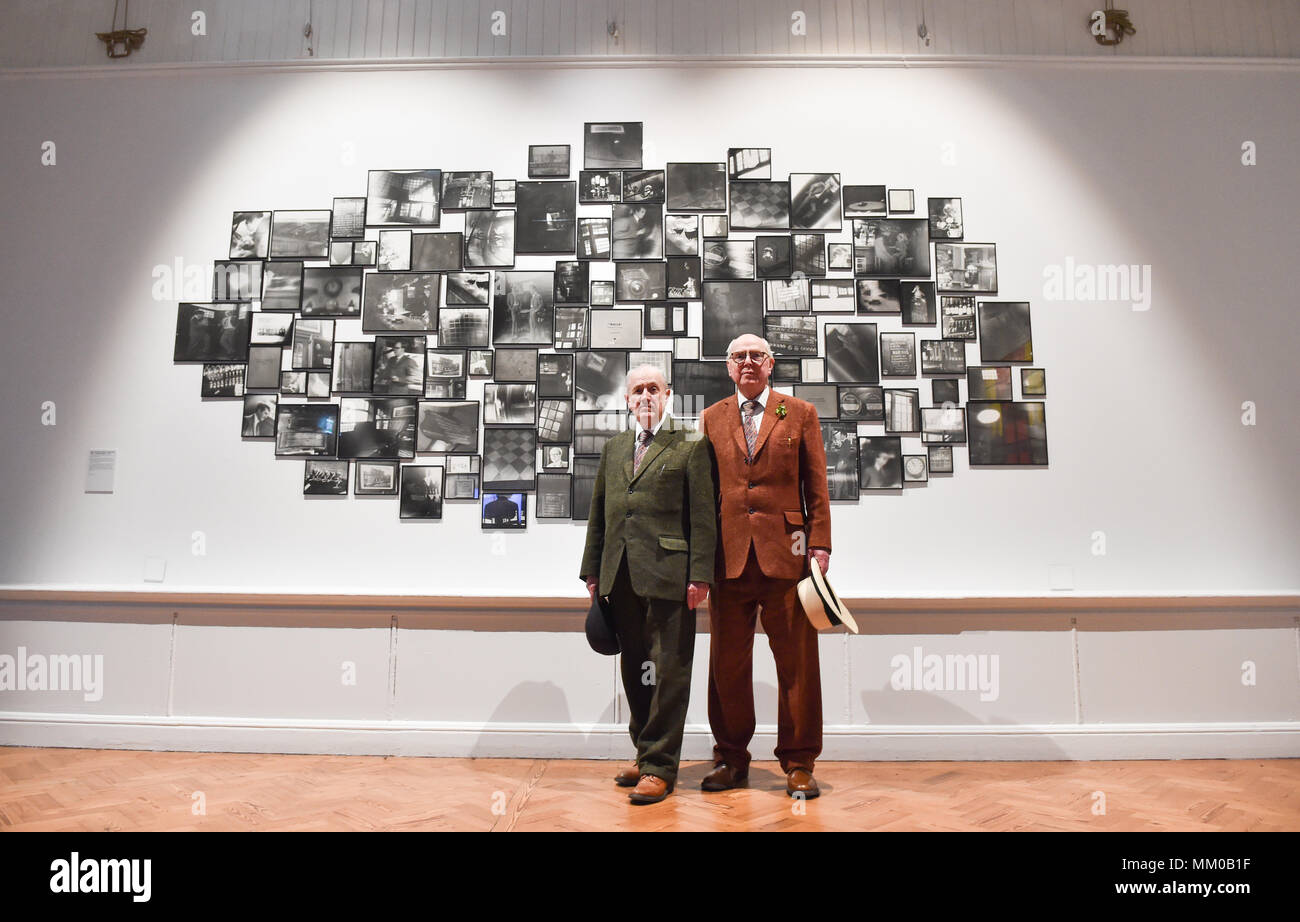 Brighton UK 9th May 2018 - Renowned artists Gilbert (left) and George visiting their exhibition at Brighton Museum and Art Gallery which is showing until September until September .   Credit: Simon Dack/Alamy Live News Stock Photo