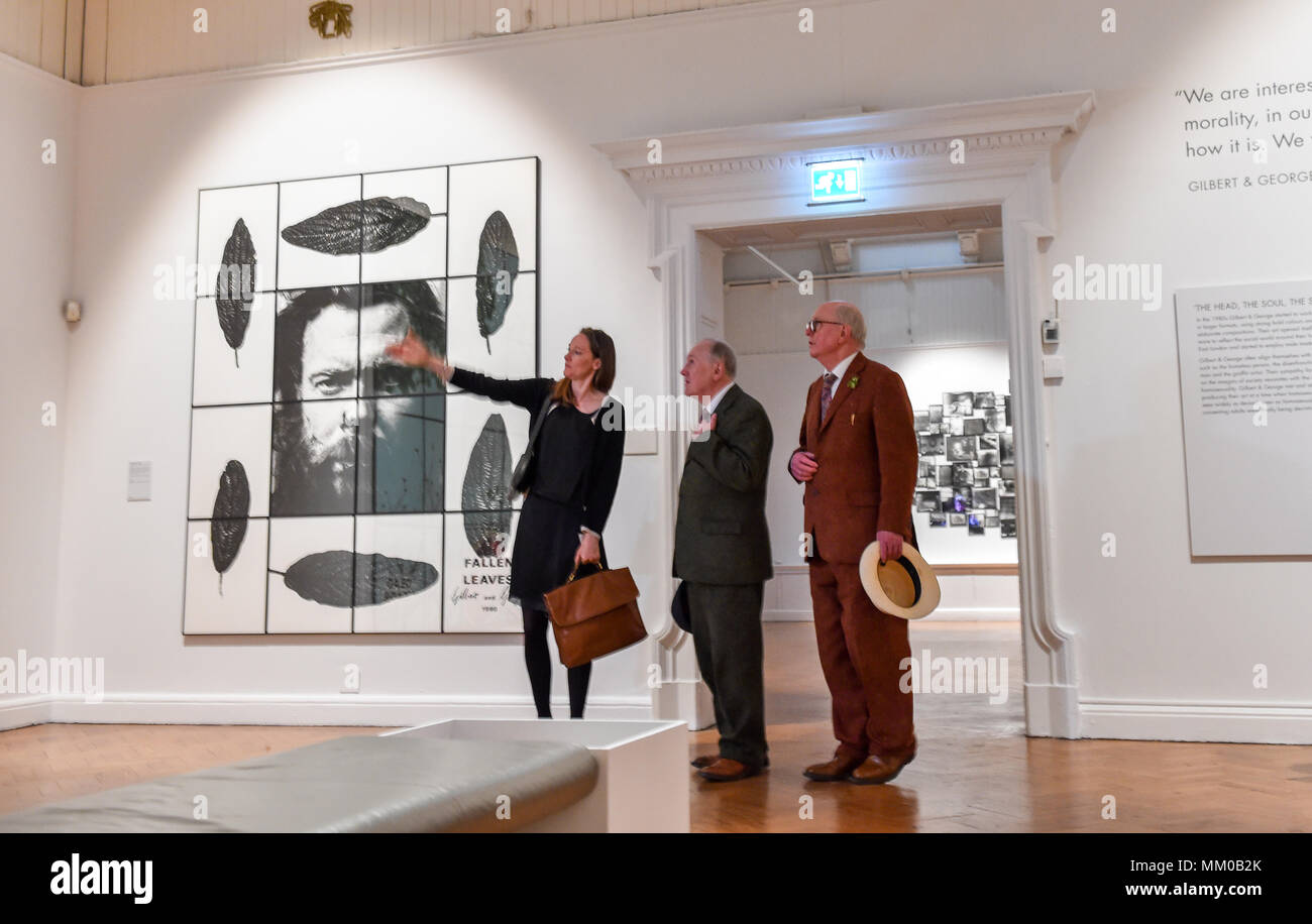 Brighton UK 9th May 2018 - Renowned artists Gilbert (left) and George visiting their exhibition at Brighton Museum and Art Gallery which is showing until September until September .  Photograph taken by Simon Dack Credit: Simon Dack/Alamy Live News Stock Photo