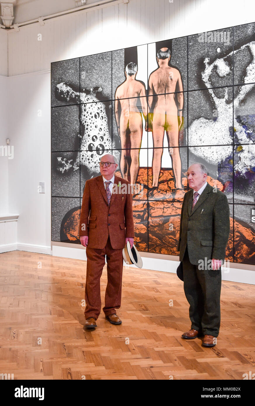 Brighton UK 9th May 2018 - Renowned artists Gilbert (right) and George visiting their exhibition at Brighton Museum and Art Gallery which is showing until September until September .   Credit: Simon Dack/Alamy Live News Stock Photo