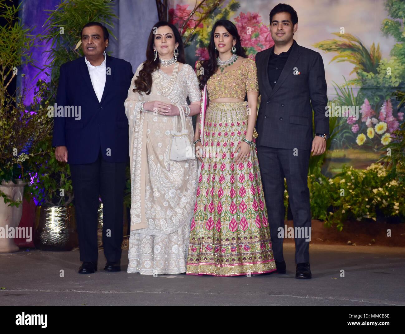 Indian businessman Mukesh Ambani with wife Nita Ambani, Shloka Mehta and Akash Ambani attend the wedding reception of actress Sonam Kapoor and Anand Ahuja at hotel Leela in Mumbai. - Stock Image