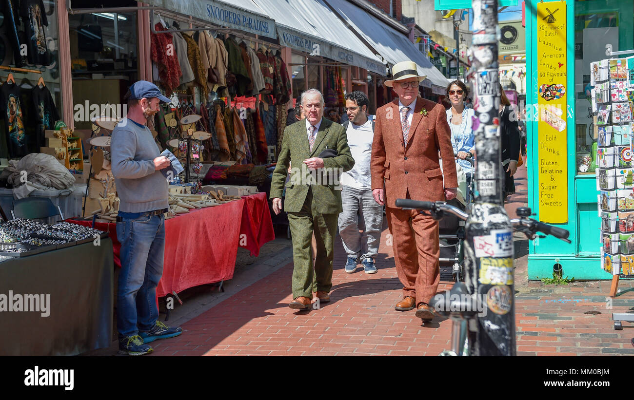 Brighton UK 9th May 2018 - Renowned artists Gilbert (left). and George walking around the North Laine area of Brighton before visiting their own exhibition at Brighton Museum and Art Gallery which is showing until September until September .  Photograph taken by Simon Dack Stock Photo