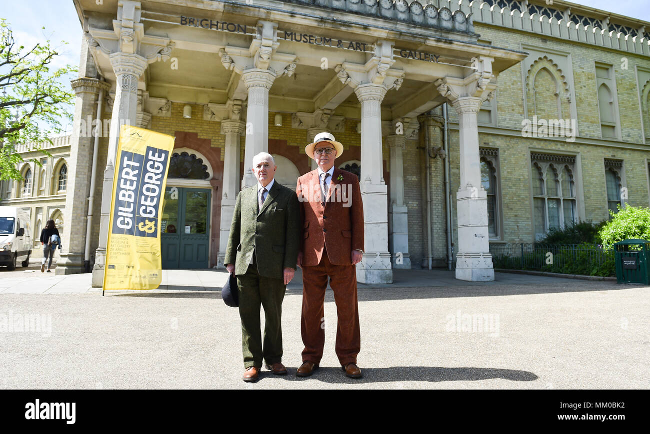 Brighton UK 9th May 2018 - Renowned artists Gilbert (left). and George visiting their own exhibition at Brighton Museum and Art Gallery which is showing until September until September .  Photograph taken by Simon Dack Stock Photo