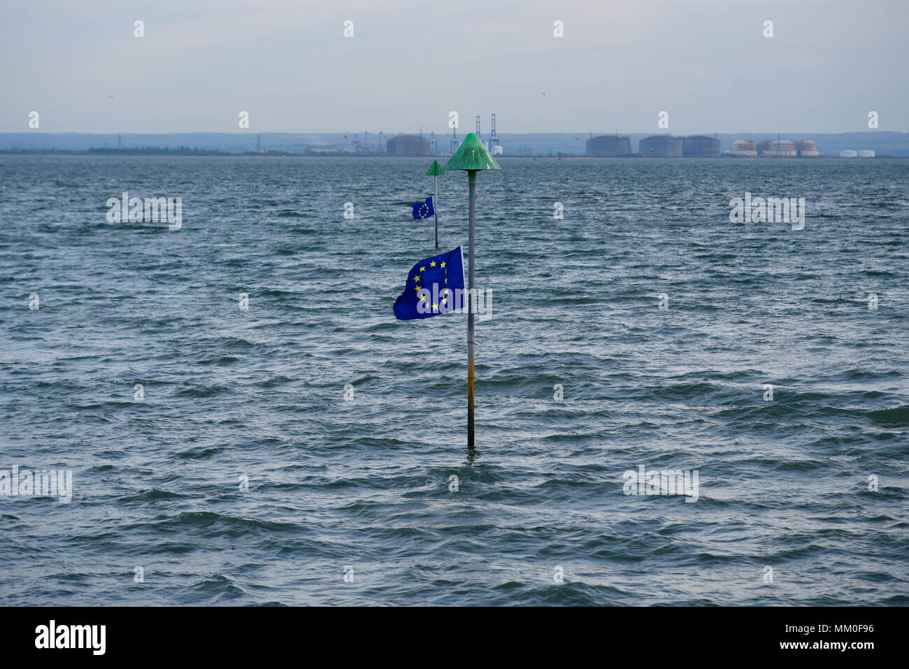 EU Flag Mafia hung 42 European Union flags along Southend seafront in the Thames Estuary. The flags were hung on Europe Day to time with the tides so that they couldn't be removed until the water receded. Anti-Brexit protest - Stock Image