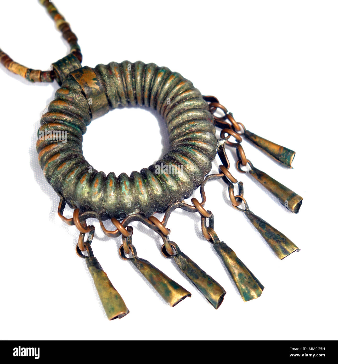 Unusual metal pendant probably made from repurposed corrugated copper tubing, Addis Abbeba, Ethiopia - Stock Image