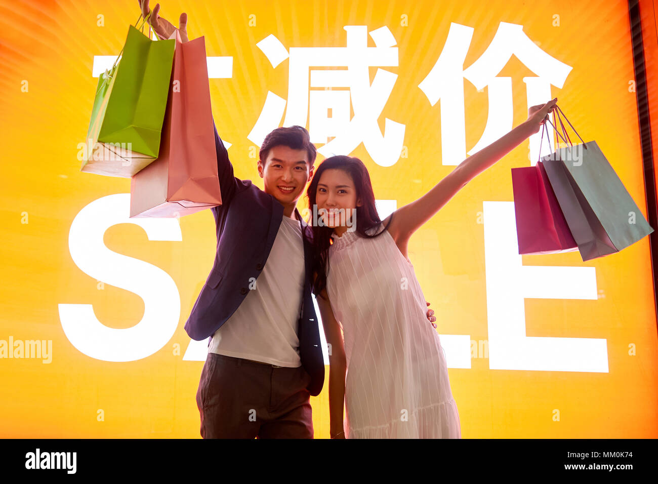 Young couples shopping - Stock Image