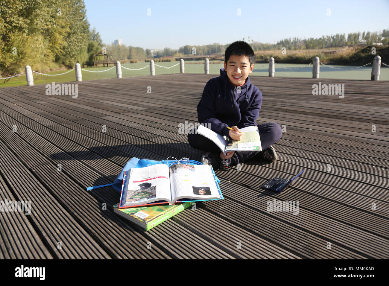 The boy studied in outdoor - Stock Image