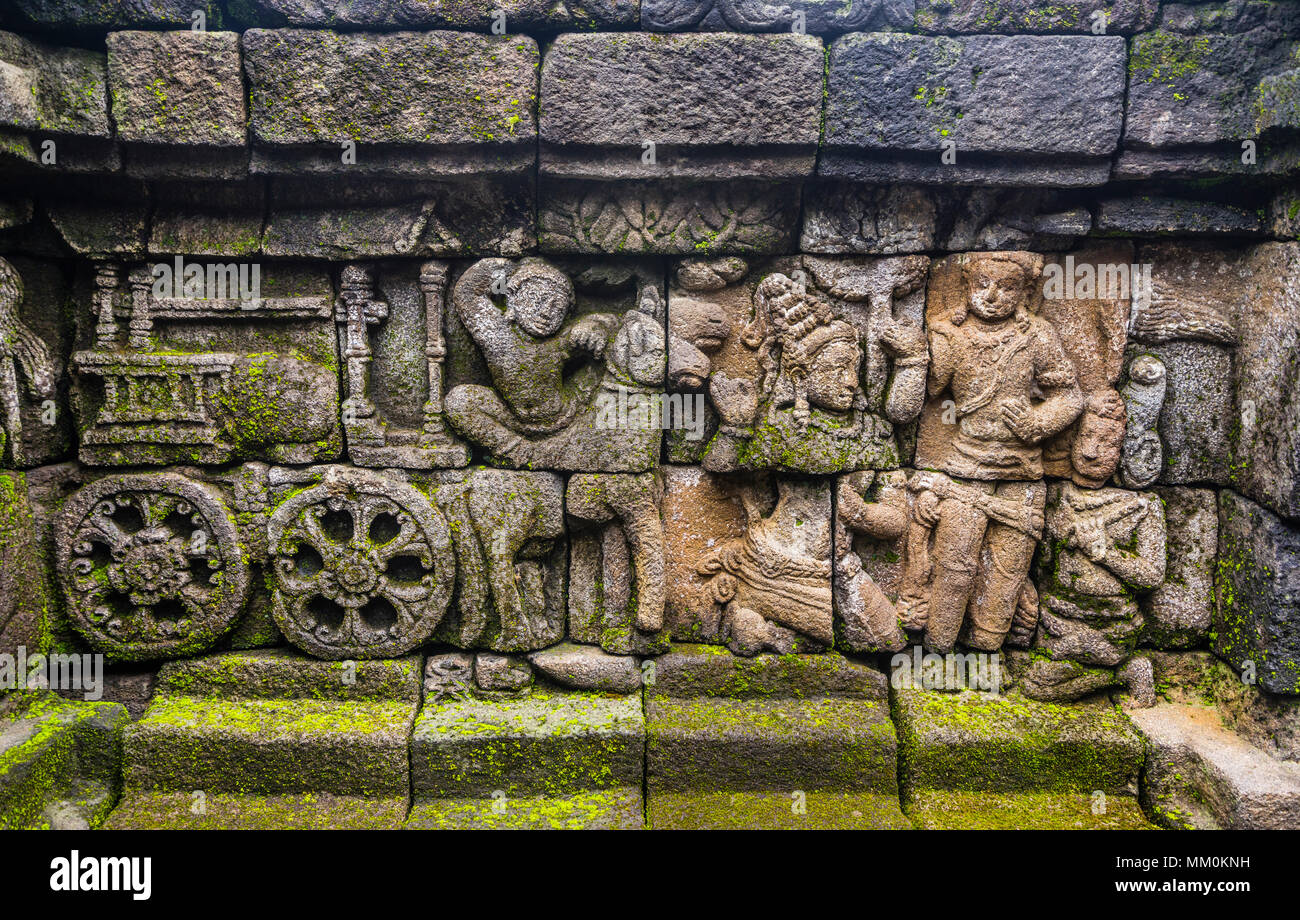 relief panels on the 4th balustrade of 9th century Borobudur Buddhist temple, the approximately 2672 panels form one of the most comprehensive Buddhis - Stock Image