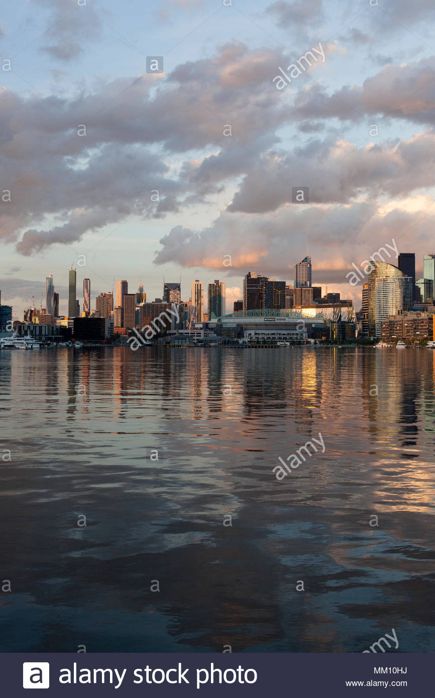 Melbourne Docklands, Victoria Harbour (Harbor), Etihad Stadium: 2018 Autumn Sunset - Colourful clouds reflecting on water with gentle ripples - v2 - Stock Image