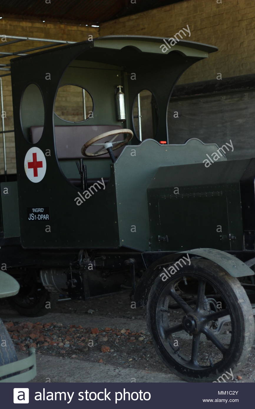 Interior shot of vehicle shed and  WW1 vehicles at Stow Maries Great War Aerodrome, Purleigh, Essex, Britain. - Stock Image