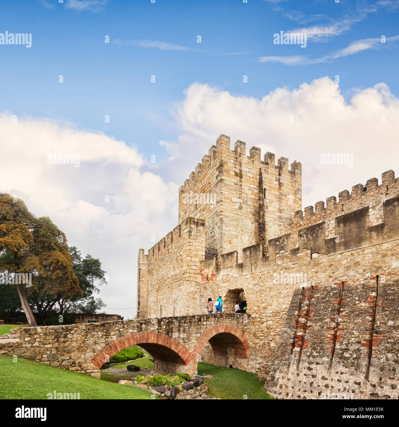 1 March 2018: Lisbon Portugal - Tourist couple crossing bridge to enter Castle of St George. - Stock Image