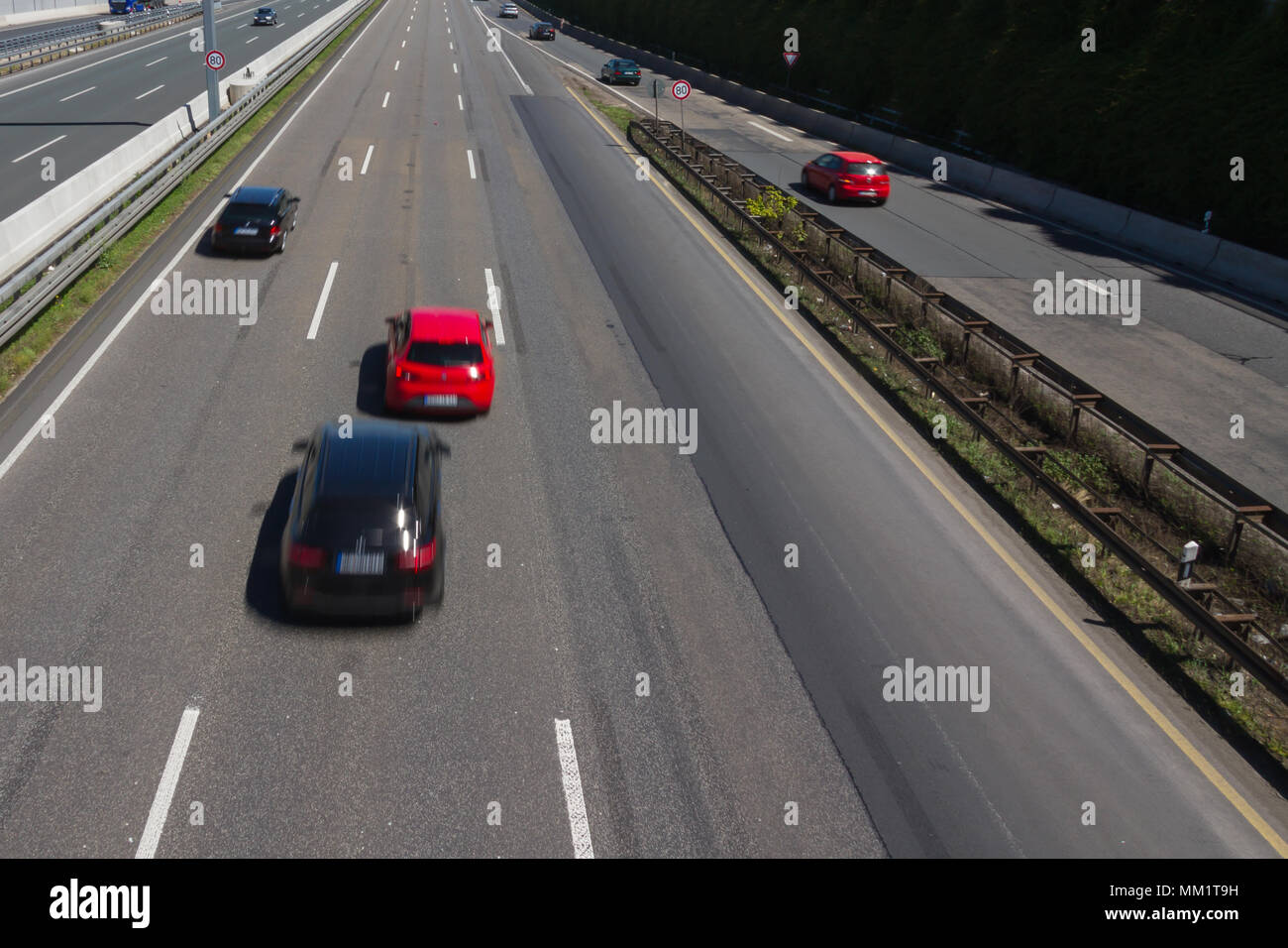 Jostling car running fast on a german autobahn - Stock Image
