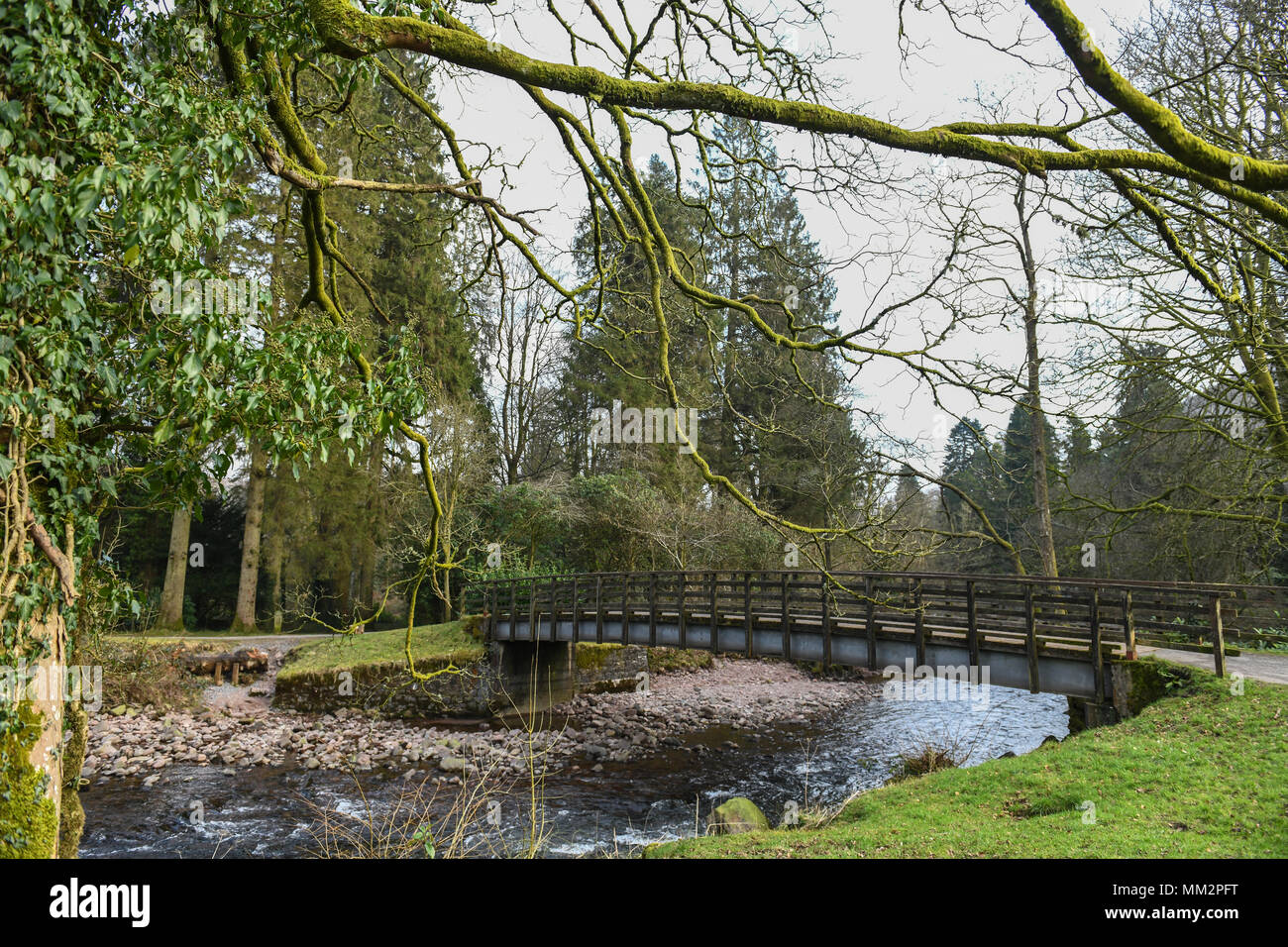 A bridge over the river Tawe at Craig y Nos in the Swansea Valley, Wales, UK. - Stock Image