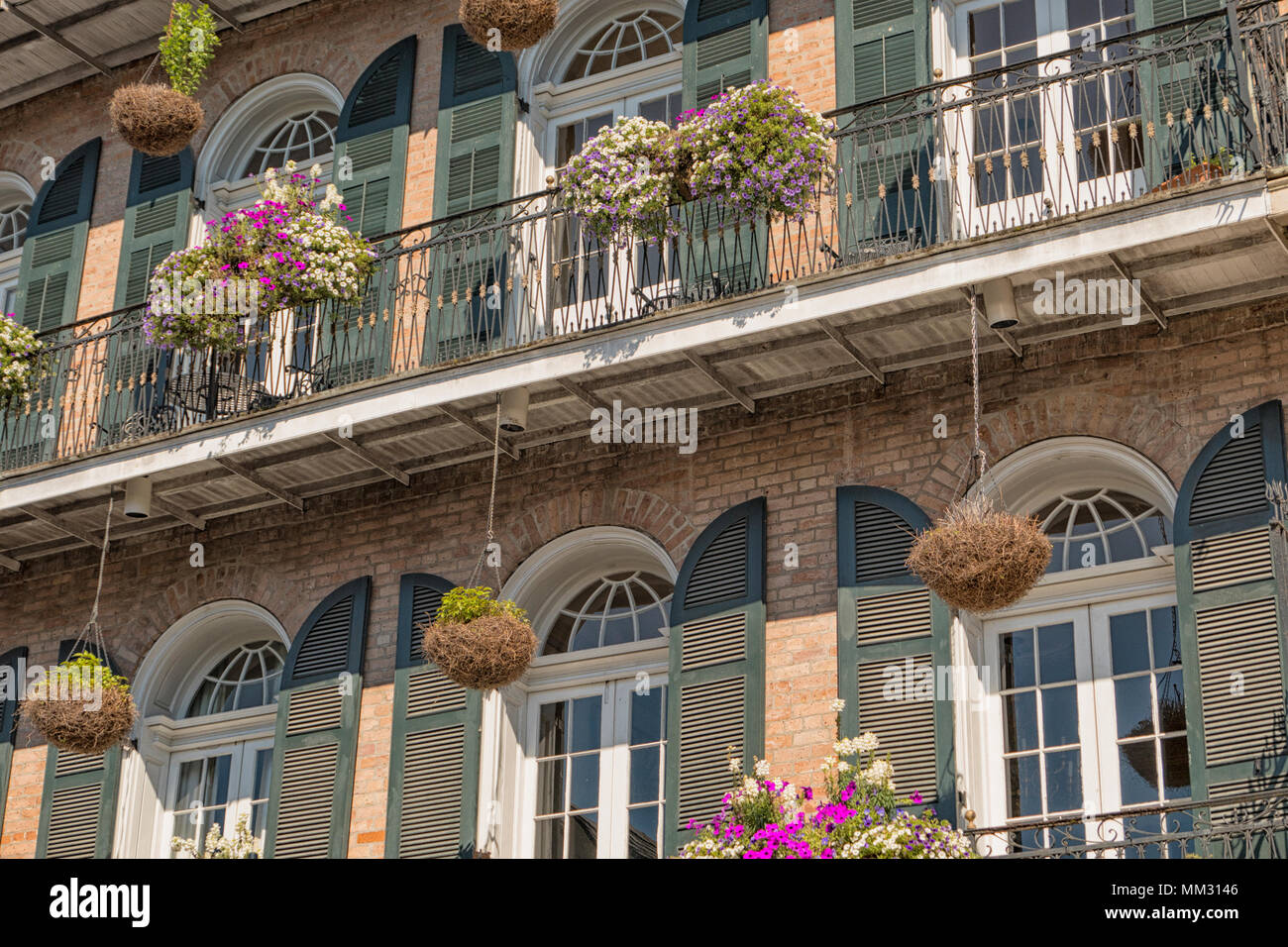 over balcony planters Hanging Planters And Window Boxes Hanging From A Wrought