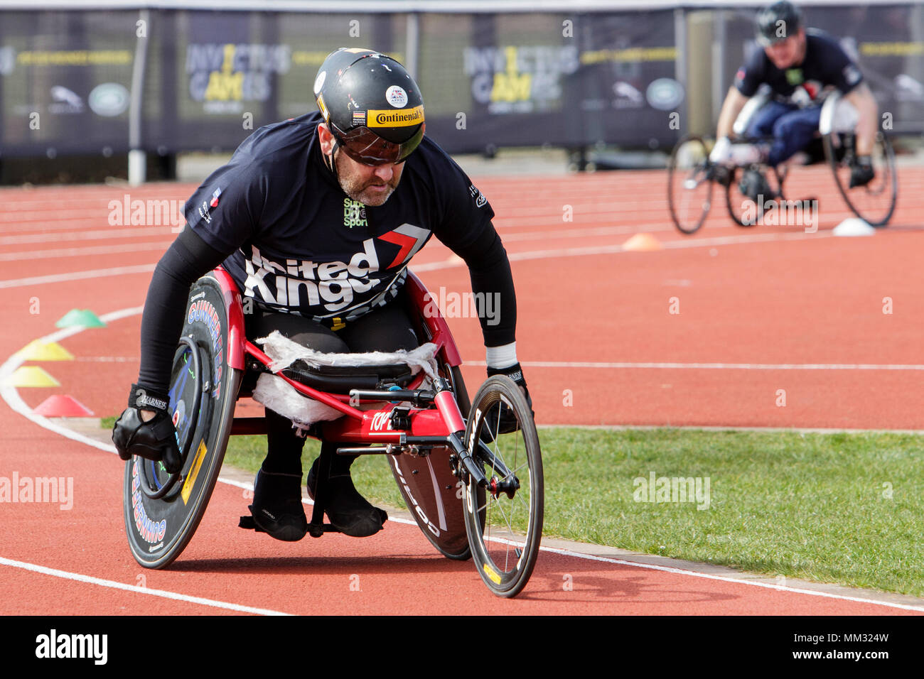 A wheelchair athlete is pictured at the University of Bath Sports Training Village as he takes part in the UK team trials for the 2018 Invictus Games. - Stock Image