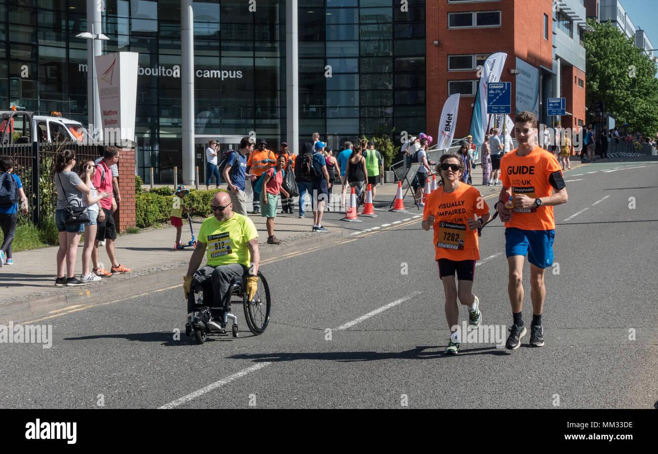 People running a marathon in the warm sunshine in Birmingham UK - Stock Image