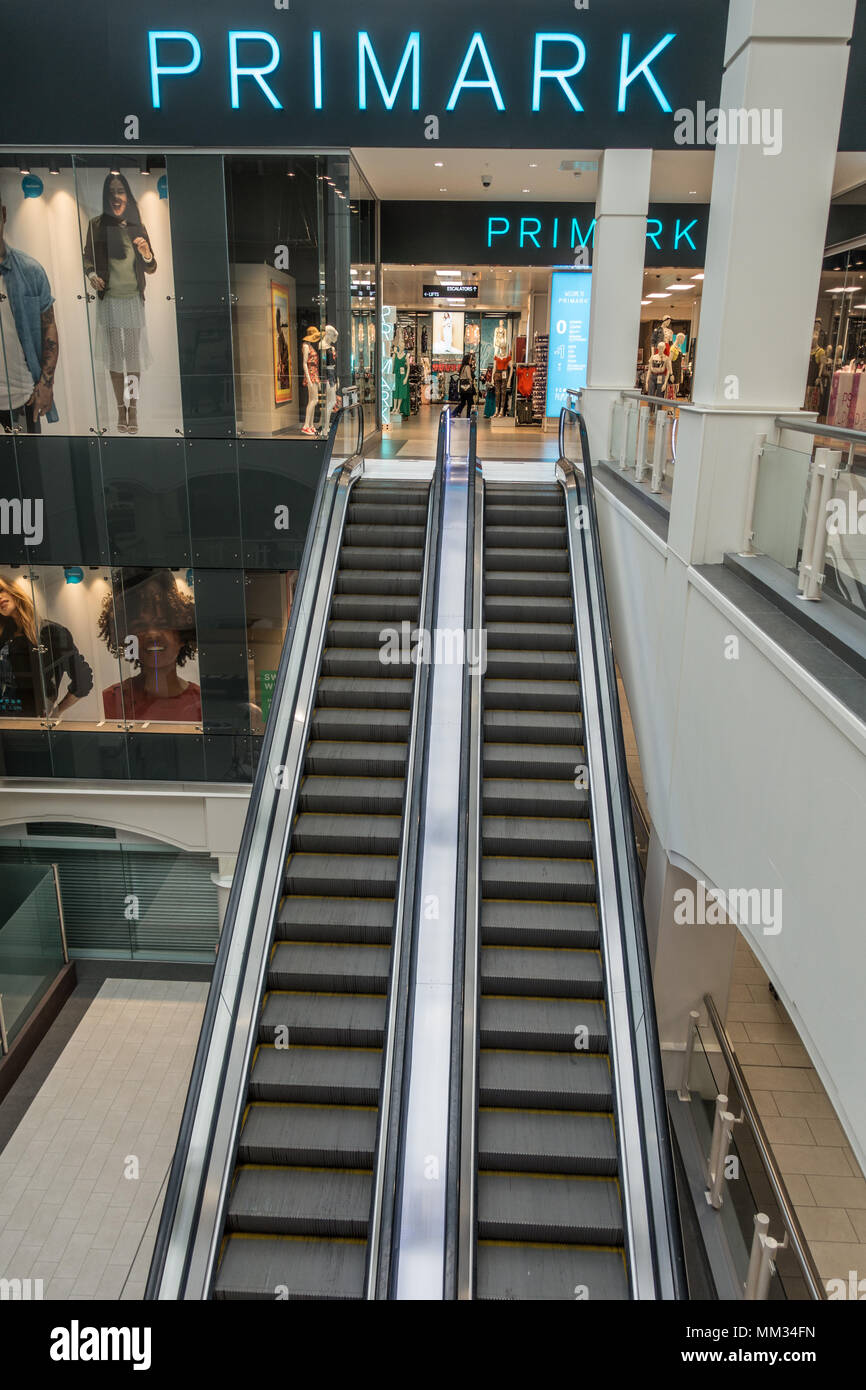 Primark shop at the top of an escalator in Shrewsbury - Stock Image
