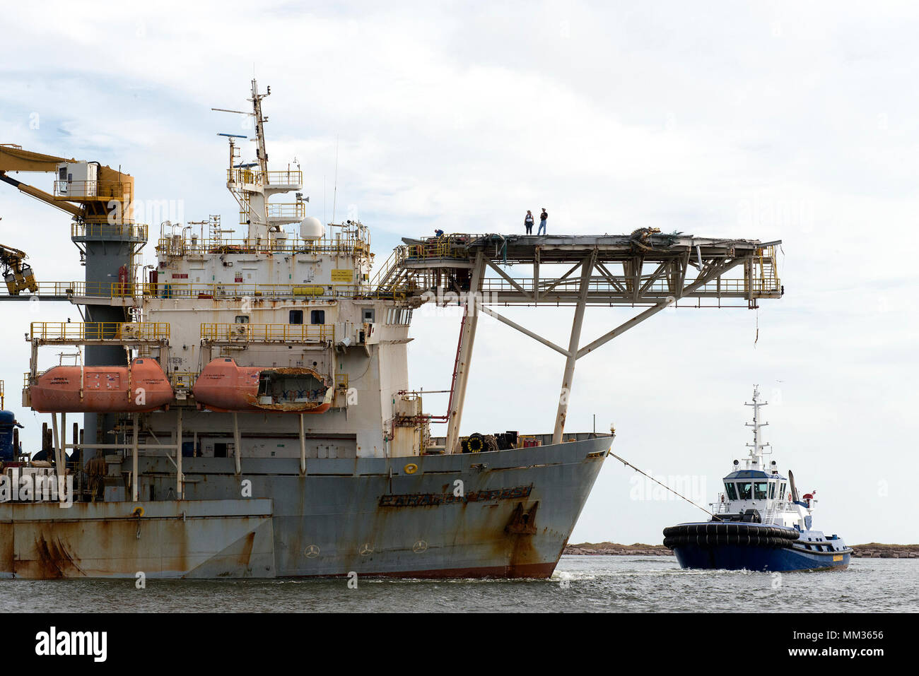 Coast Guard monitors the recovery and transit of the grounded drill ship Paragon DPDS1, Sept. 4, 2017, in the Aransas Pass near Corpus Christi, Texas.     After the Coast Guard approved the salvage plan for the drill ship, the vessel was recovered and towed to Gulf Marine Fabricators in Corpus Christi, Texas. U.S. Coast Guard photo by Petty Officer 2nd Class Cory J. Mendenhall. - Stock Image
