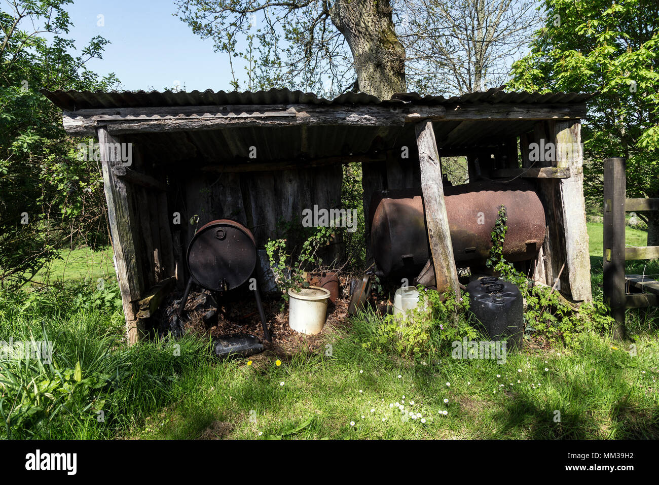rural oil store,A container for holding or storing oil.,lubricant, lubrication, grease,power source, heat source, combustible, propellant,joist, purli - Stock Image