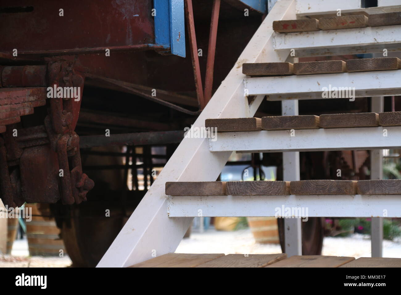 An old railroad car and stairs - Stock Image