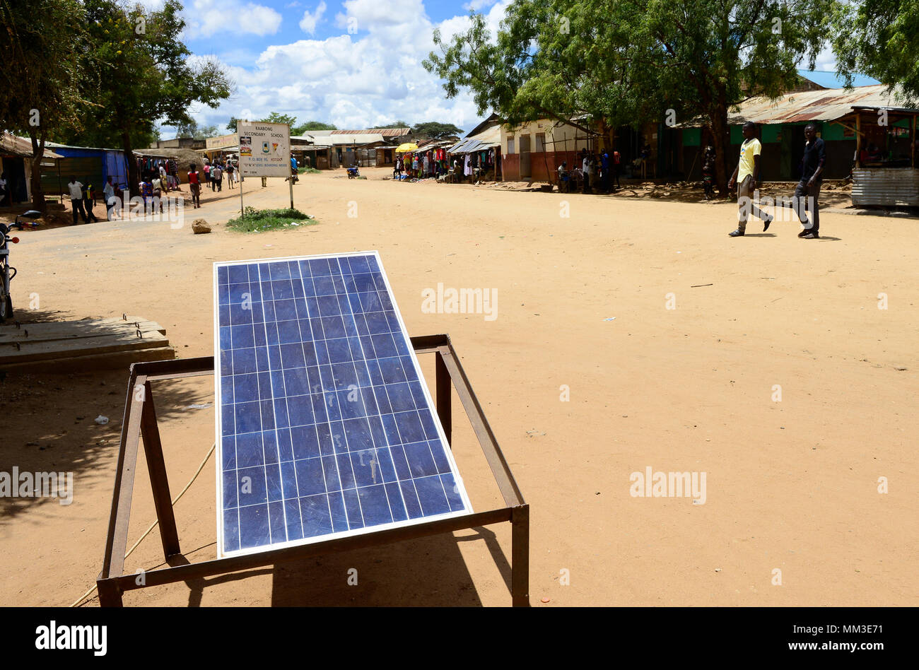 UGANDA, Karamoja, Kaabong, Karamojong pastoral tribe, solar panels for power generation and battery recharging - Stock Image