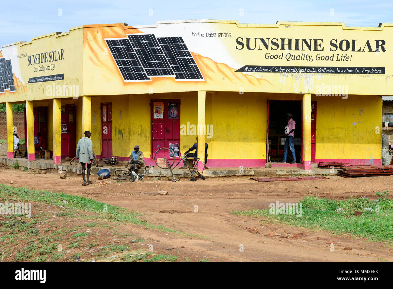 UGANDA, Karamoja, Kotido, Karamojong pastoral tribe, shop selling solar panels for power generation and bicycle repair - Stock Image