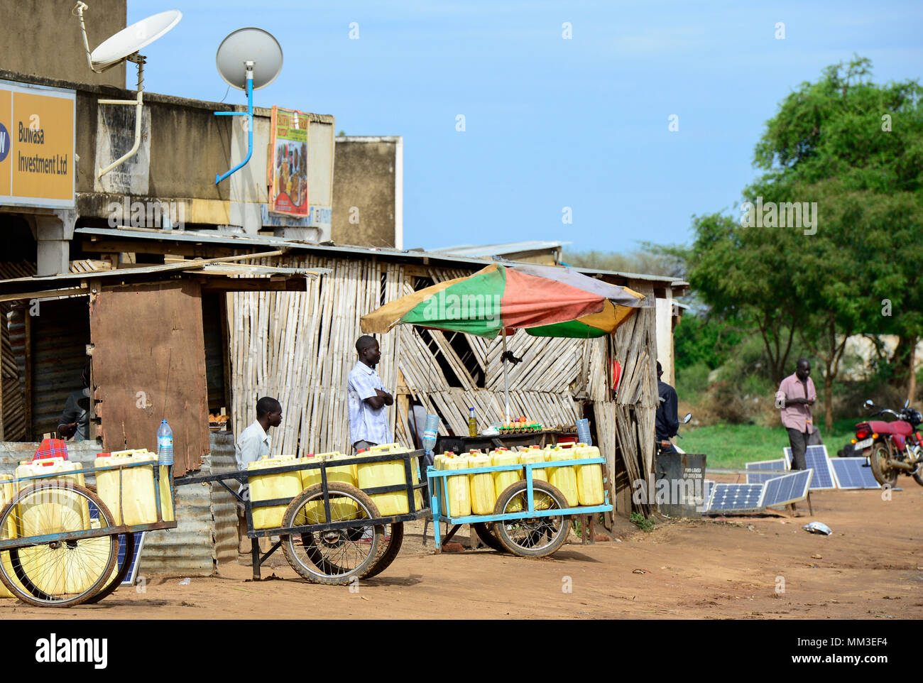 UGANDA, Karamoja, Kotido, Karamojong pastoral tribe, jerry cans for water transport and solar panels for power generation and battery recharging - Stock Image