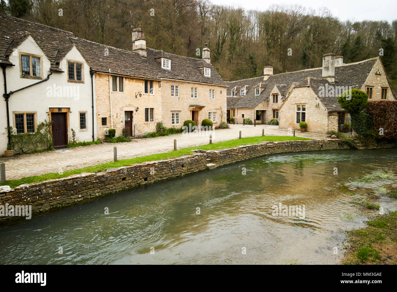 water lane wool weaver workers cottages with steps down to the by brook Castle Combe village wiltshire england uk - Stock Image