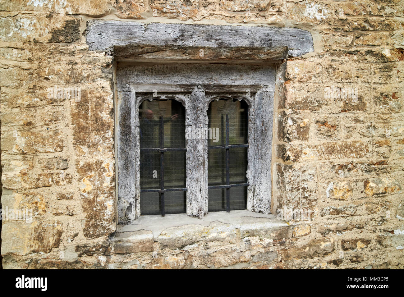 old historic small wood framed window in brick building Castle Combe village wiltshire england uk - Stock Image