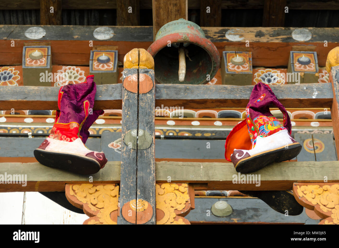 Traditional boots on fence at fortress and monastery, Dzong, Trongsa, Bhutan - Stock Image