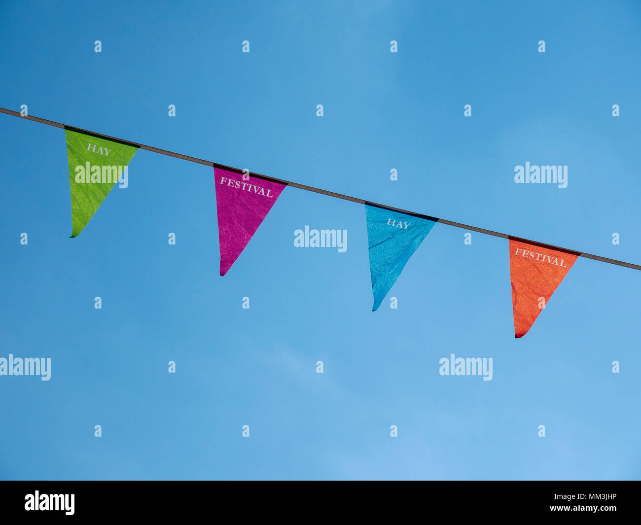 Colourful bunting in Hay-on-Wye advertise the Hay Festival for 2018 - Stock Image