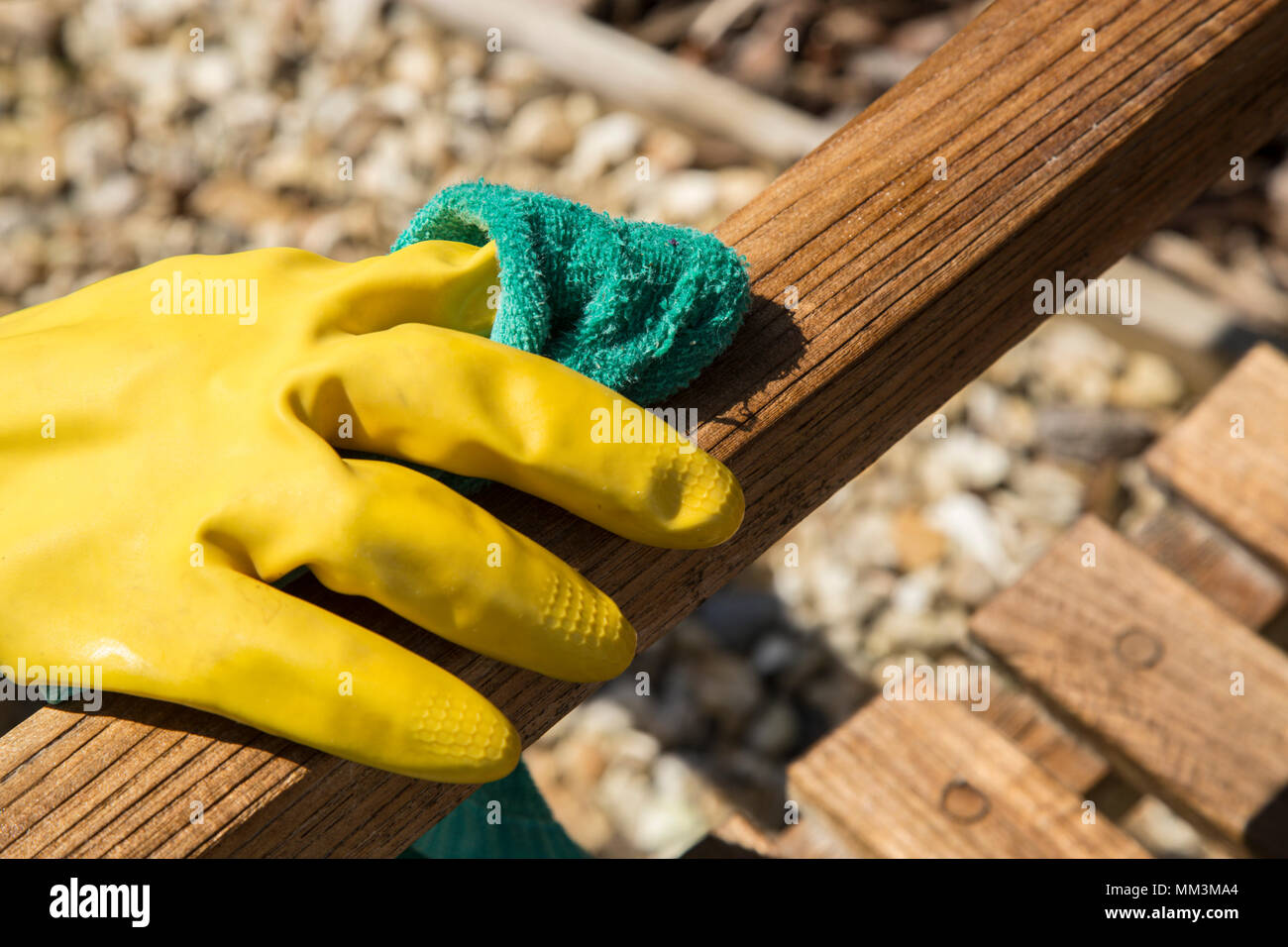 Applying Teak Oil As A Preservative To A Teak Garden Bench Using