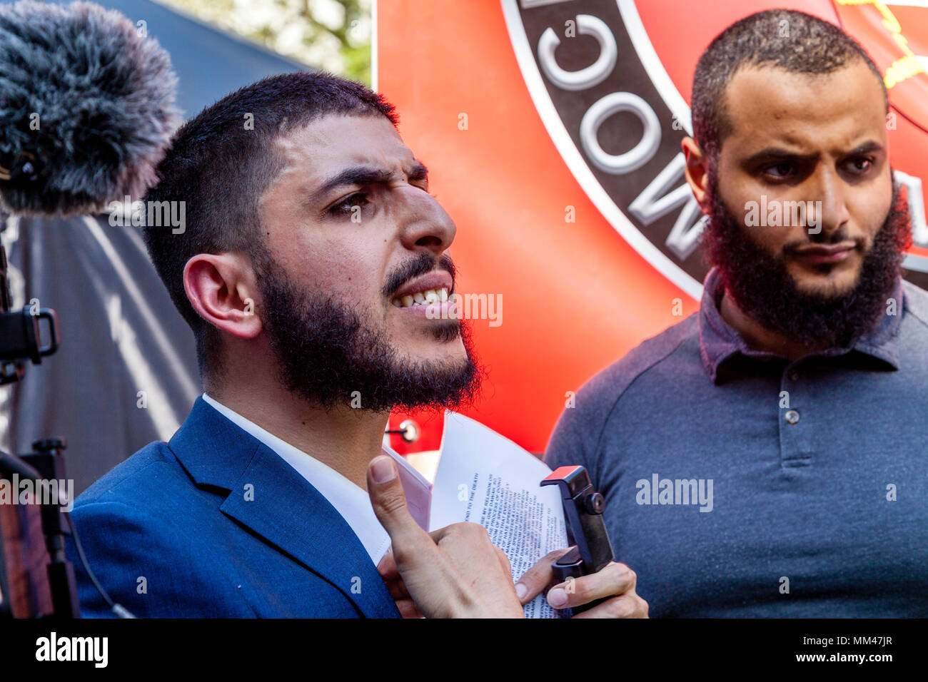 Ali Dawah a prominent Muslim speaker argues for the right to read a speech at the day for freedom rally. London, UK - Stock Image