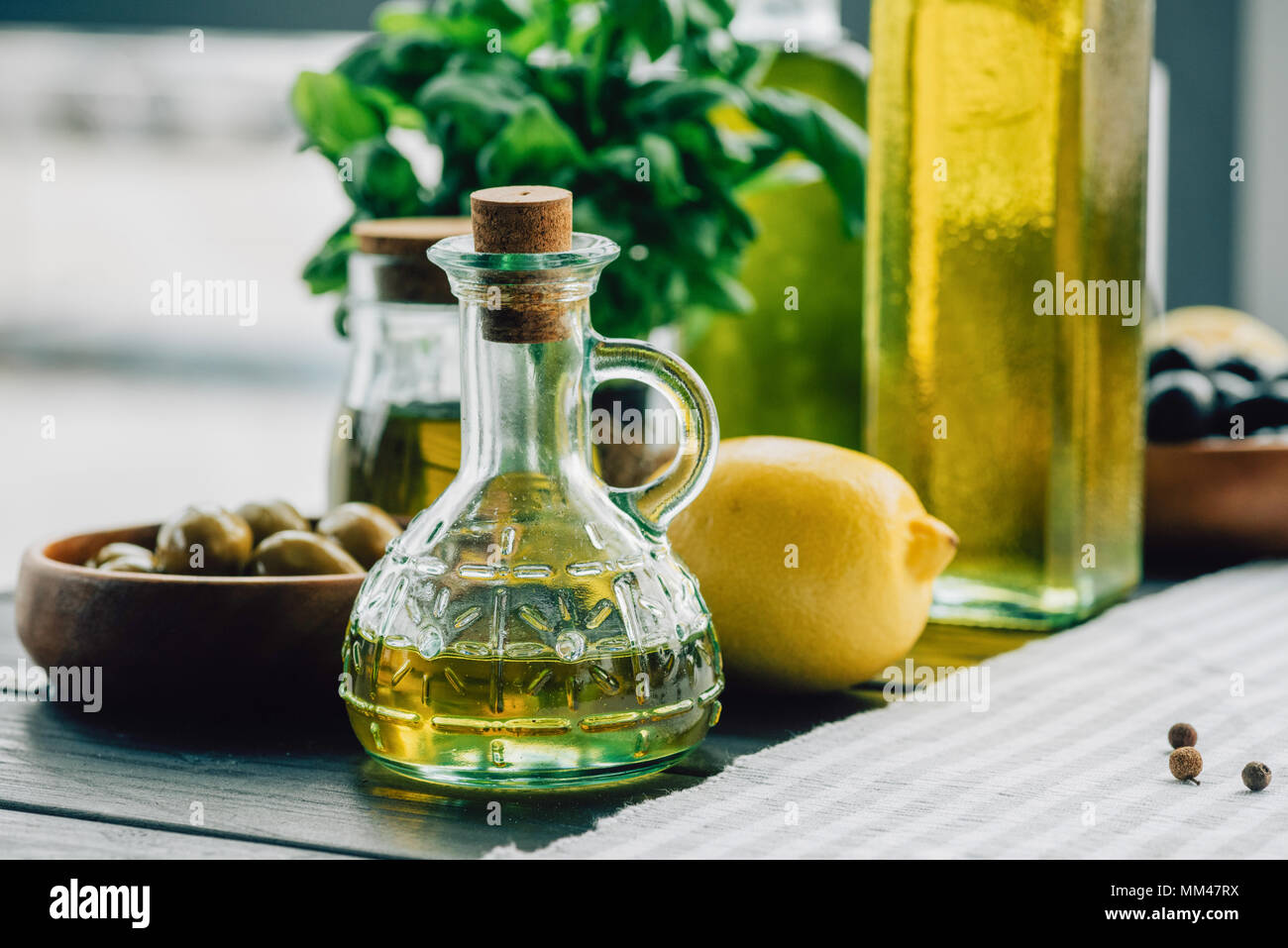 olive oil bottles with vegetables - Stock Image