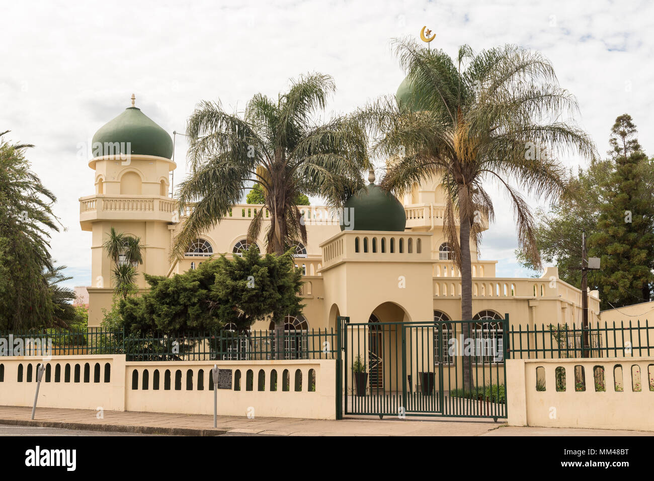 DUNDEE, SOUTH AFRICA - MARCH 21, 2018: A mosque, with palm trees in front, in Dundee in the Kwazulu-Natal Province - Stock Image