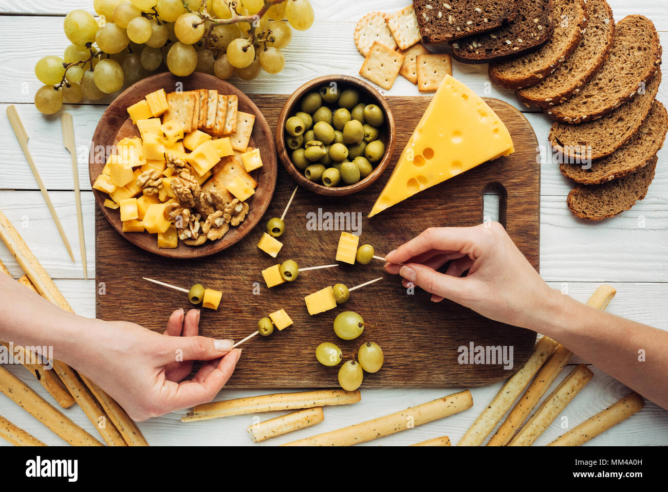 women making canapes with cheese - Stock Image