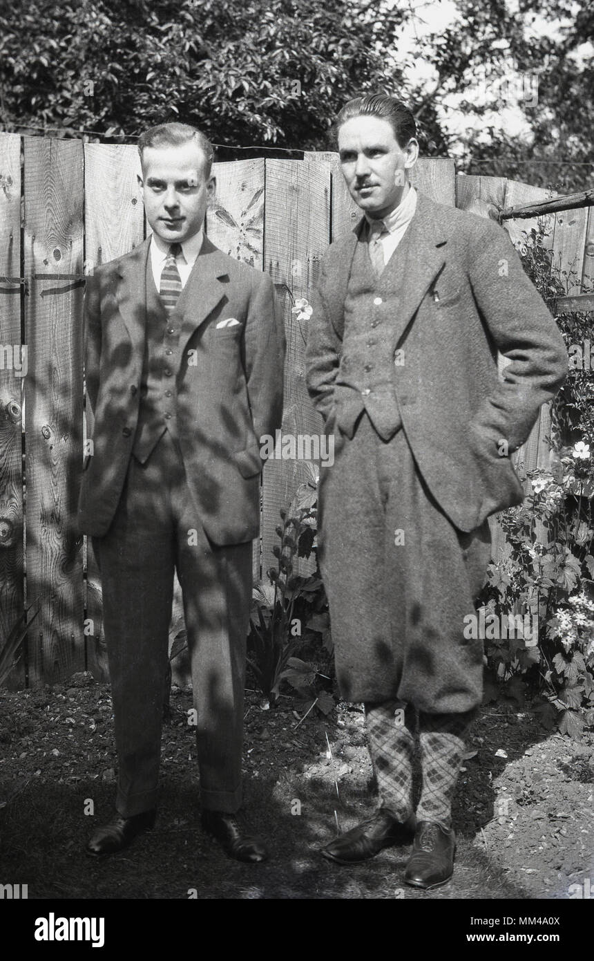 1930s, historical, two well-dressed English gentlemen stand in a back garden wearing the male fashions of the day, England, uk. - Stock Image