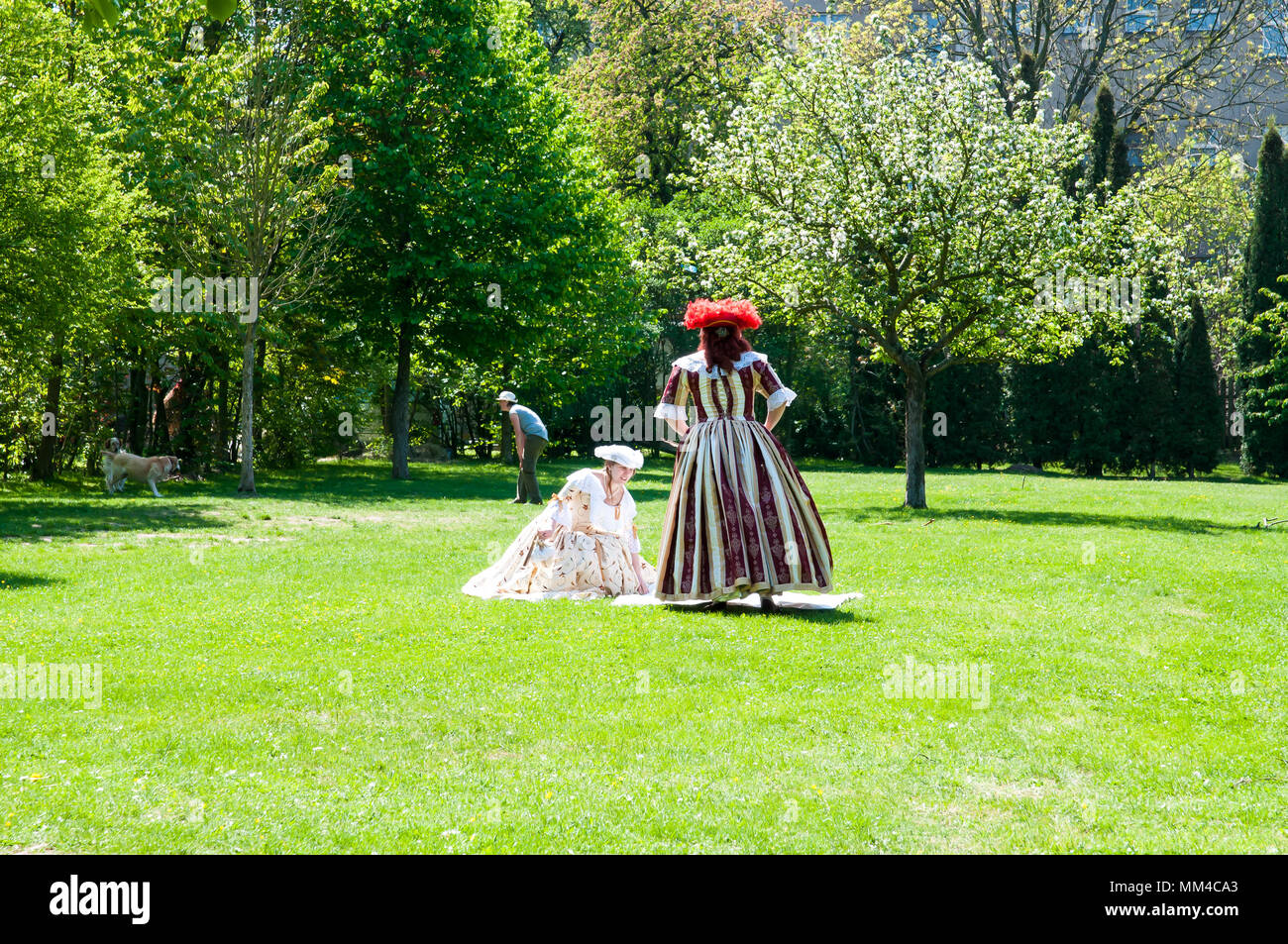 Brandys nL, Czech Republic, 28 April 2018, ladies dressed in baroque dresses at Audiences at the Emperor Charles I relax in the castle garden - Stock Image
