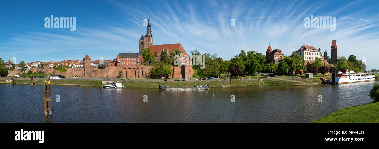 Panoramic view of Tangermünde on Elbe river with city wall, St Stephens church, castle and retired river cruise ship - Stock Image